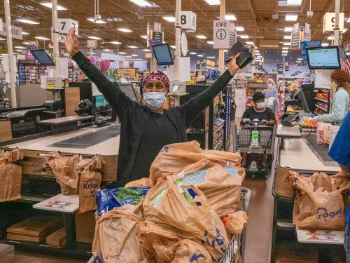 Tyler Perry surprised seniors and at-risk shoppers by buying their groceries at 44 stores across Atlanta - take a look