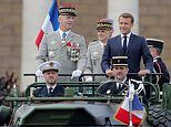 Emmanuel Macron and his wife watch scaled-down Bastille Day celebrations