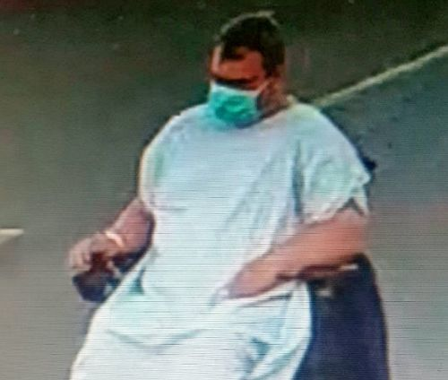 Urgent search for patient in wheelchair who fled hospital in gown and face mask