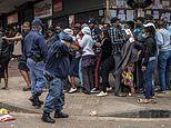 Police in South Africa fire RUBBER BULLETS at hundreds of shoppers