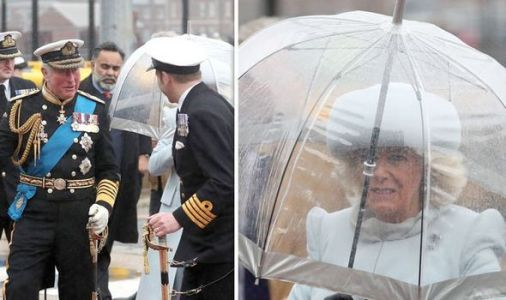Camilla struggles with pouring rain as she boards the new £3BILLION HMS Prince Charles
