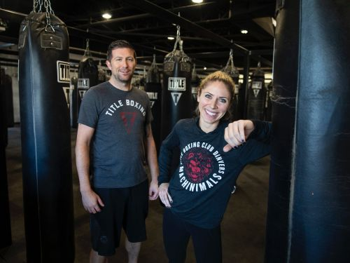 A pharmacist who loved boxing left her job, got a bank loan, and bought a declining gym for $600,000 with her husband. Here's an inside look on how they cut cancellation rates in half and got the business growing again