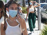 Madison Beer shows off sporty style in green and white ensemble in Beverly Hills