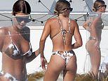 Sofia Richie showcases her curves in a cow print bikini after reuniting with ex Scott Disick
