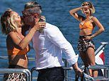 Pip Edwards and Michael Clarke kiss on luxury yacht in Sydney