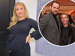 Pregnant Dani Dyer shows off her blossoming baby bump in black dress