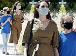 Angelina Jolie and daughter Vivienne, 11, keep their masks on as they emerge from lockdown