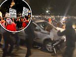 Footage shows moment a driver plowed through BLM protesters during Breonna Taylor protest in Denver
