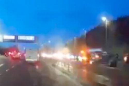 Two hospitalised after M77 fire and four-car crash
