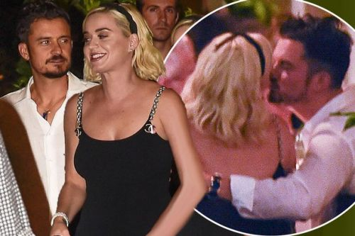 Katy Perry & Orlando Bloom snuggle at wedding party as Harry & Meghan keep low profile
