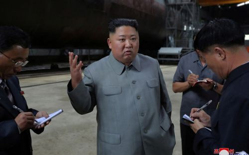 North Korea's Kim Jong-un inspects new submarine, points out weapons systems