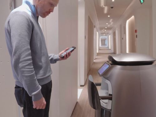 Chinese e-commerce giant Alibaba has a hotel run almost entirely by robots that can serve food and fetch toiletries - take a look inside