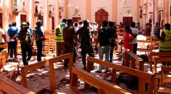 Seven arrests after bombs at hotels and churches in Sri Lanka leave at least 207 dead