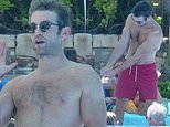 Chace Crawford showcases his ripped biceps as he goes shirtless in Cabo