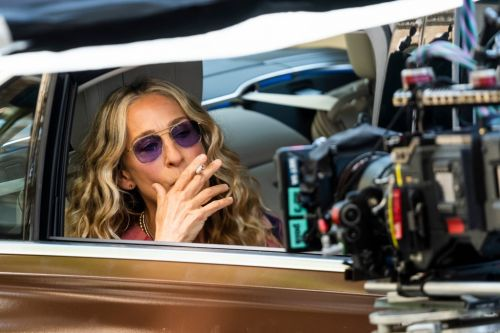 Carrie Bradshaw is puffing on a cigarette so Sex and The City is really back