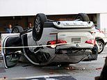 BMW plummets from third floor of car park before flipping and landing on another vehicle