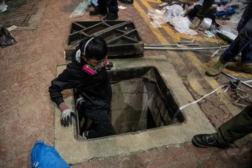 Protesters make desperate escape through sewers as Hong Kong siege continues