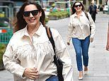 Kelly Brook channels cowgirl vibes in fringed white jacket and jeans as she arrives at Global Radio