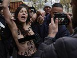 Topless demonstrator joins in anti-Islamophobia march through the streets of Paris