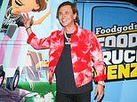 Jonathan Cheban rolls up his sleeves to serve dinner from a truck to promote his Foodgod game