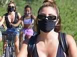 Kim Kardashian's friend Larsa Pippen models a plunging top for bike ride with daughter Sophia, 12