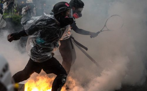 Hong Kong police officer 'fires warning shot' amid fresh clashes with protesters