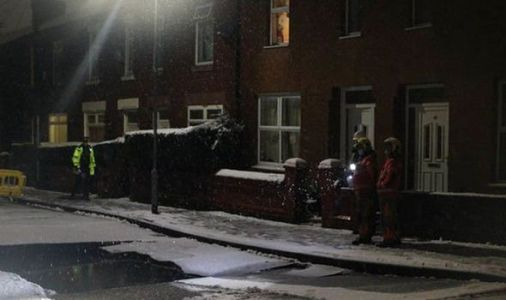 Giant sinkhole swallows up car as heavy snow falls in Manchester