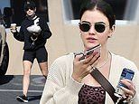 Lucy Hale wears black athletic shorts as she heads to a foot massage after hitting the gym in WeHo