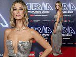 ARIAs host Delta Goodrem shows off her ample assets as she arrives at the music award show