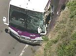 Bus carrying 11 passengers is found mangled on the side of the road after crashing with another car