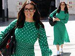 Kym Marsh styles her green dress with white trainers while leaving BBC studios