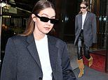 Gigi Hadid oozes androgynous chic in an oversized grey blazer in Paris