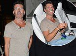 Simon Cowell showcases his slimline figure and puffs on a cigarette while leaving the BGT auditions