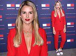 Vogue Williams goes braless under a bright red suit at Tommy Hilfiger's LFW show