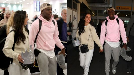 Love Island runner up Siannise Fudge clutches onto Luke Trotman's crown as they land in UK
