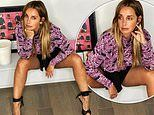 Louise Redknapp puts on a very leggy display as she poses up a storm in black shorts