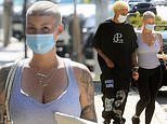 Amber Rose and boyfriend Alexander Edwards hold hands as they leave baby Slash at home