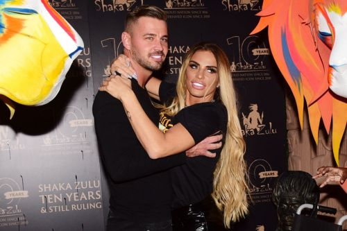 Katie Price and boyfriend Carl Woods flip the bird at their 'doubters and haters' as romance blossoms