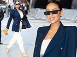 Shay Mitchell cuts a chic figure in a navy blazer worn over white outfit in New York City