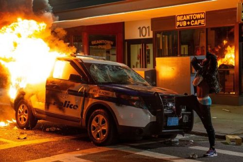Cops and George Floyd protesters in violent clashes as US burns for sixth night