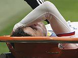 Lyon players are left shaken as Martin Terrier is carried off after collapsing without contact