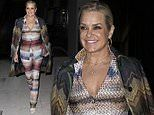 Yolanda Hadid, 56, catches the eye in multi-coloured suit as she steps out during Milan Fashion Week