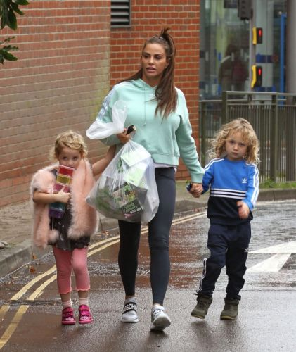 Katie Price returns to her mucky mansion as she finally gives her kids Christmas presents THREE weeks late
