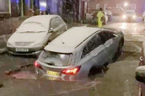 Storm Christoph chaos as car 'swallowed' by huge sinkhole on street