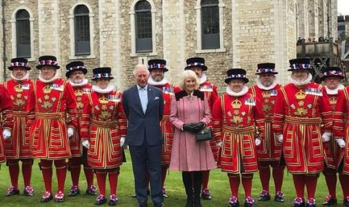 Don't lock us up! Charles and Camilla pose with Beefeaters at Tower of London