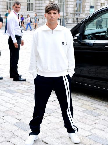 Louis Tomlinson rocks up to X Factor press conference in his trackies as he's confirmed as judge