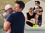 Declan Donnelly and Ali Astall take daughter Isla, 14 months, for a paddle in the Australian sea