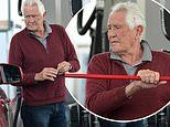 James Bond actor George Lazenby, 80, washes hands and windows at gas station in Los Angeles