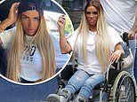 Katie Price will be in a wheelchair for SIX more months as she heals from foot surgery