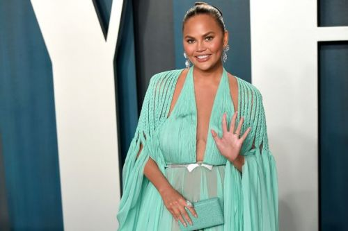Chrissy Teigen 'getting her boobs out' as she heads for surgery after Covid test